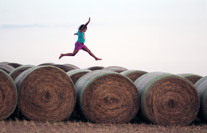 Sophie_jumping bales copy